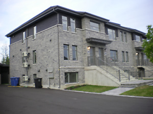 Condos neufs 51/2 (option garage)...Longueuil/St-Hubert