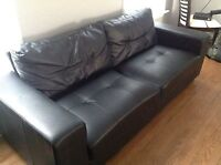 Black leather couches - great condition.