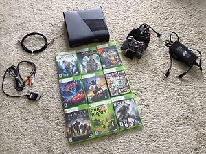 XBOX 360 Slim Kinect + 2 controllers and charging dock + games