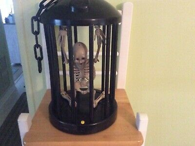 GEMMY Ind. Skeleton In Cage Halloween Animated Lights Sound And Motion Halloween