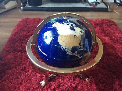 semi precious gem stone globe set in a brass style frame complete with compass