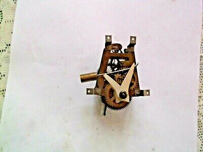 A MECHANISM  FROM AN OLD SMALL CUCKOO CLOCK WORKING ORDER REF V9