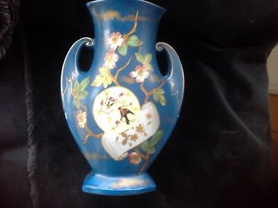Antique late 19c pottery blue two handled vase probably European.