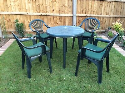 Green Plastic Round Garden Table + 4 Chairs + 4 Cushions - VGC - COLLECTION ONLY