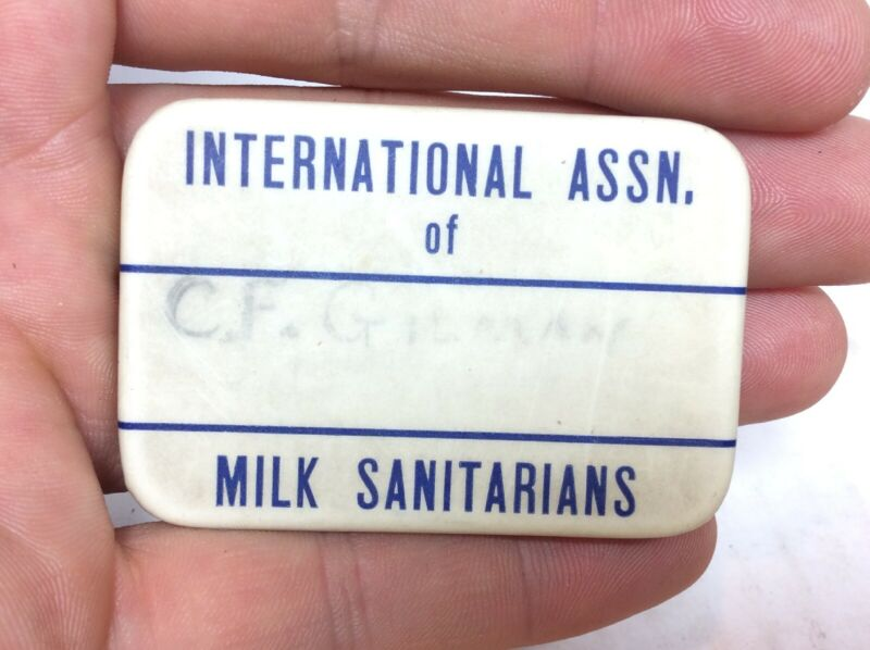 INTERNATIONAL ASSOCIATION OF MILK SANITARIANS DAIRY CELLULOID BADGE PIN NAMETAG