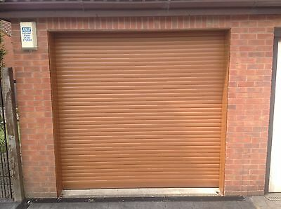 GARAGE DOOR ELECTRIC ROLLER 9 FT X 8FT NEW  INSULATED WITH 2 REMOTES  OAK