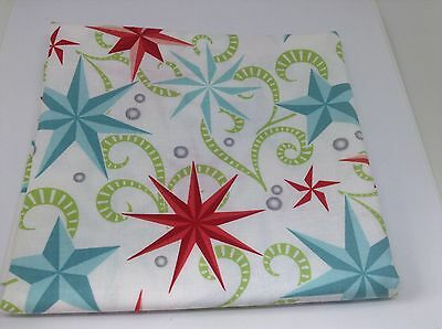Christmas Coloured Stars on White Fabric. 1M X 112cm.