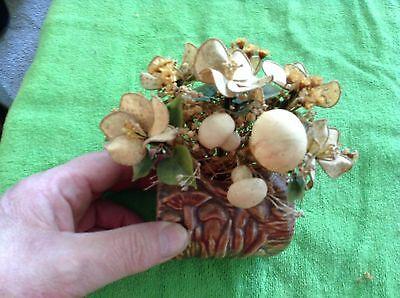 Ceramic log with artificial flower arrangement in it - Ceramic Flower