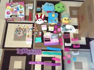 A bunch of shopkins sets, shopkins, stuffed animals, and games.