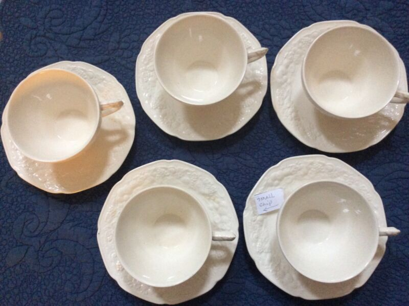 "Crown Ducal cream ""Florentine"" cups and saucers"