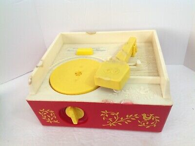 Vintage 1971 Fisher-Price music box record player complete with 5 Records