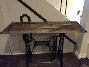 Barn board table with singer base.