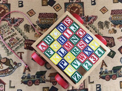 Wooden blocks with alphabet, numbers and pictures in trolley. Pakenham Cardinia Area Preview