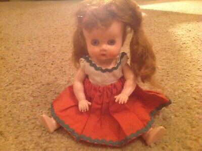 SMALL VINTAGE HARD PLASTIC DOLL WITH BUNCHES AND ORIGINAL COSTUME