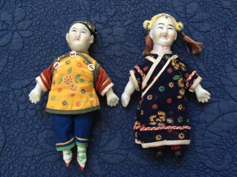 Pair of porcelain/cloth Chinese dolls