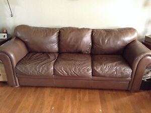 Brown real leather Coja couch and love seat from Barnaby's