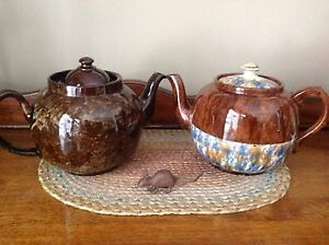 Several tea pots, some vintage.