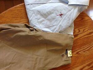 6 pieces of St. Theresa's Catholic HIgh School Uniform.