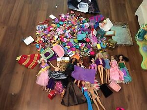 Large assortment of barbies and many accessories!