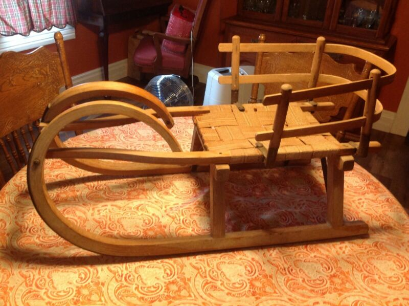 Antique Primitive Wooden Rams Head Style Sleigh Woven Seat Metal Over Wood Rails