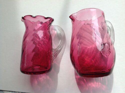 2 Cranberry Glass Pitchers