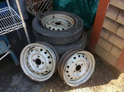 TRIUMPH   TR3 steel rims set of 5 with 4 hubcaps
