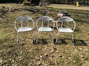 3 White foldable deck chairs