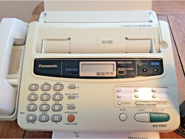 PANASONIC KX F330 FAX PHONE WITH INSTRUCTIONS BOOKLET AND 2 PAPER ROLLS.