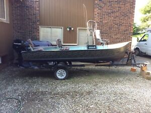 14'  camo fishing boat with 9.9h.p 4 stroke mercury outboard