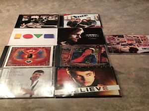 9 CDs Bon Jovi, Marc Dupré,Simple Plan, Justin Bieber, Journey,.