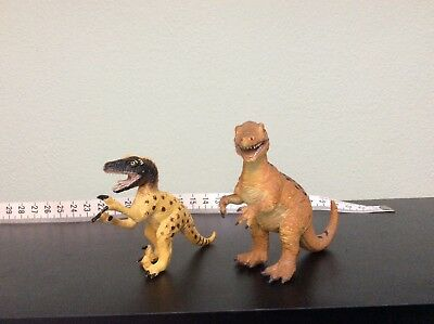 Dinosaurs Allosaurus and Utahraptor