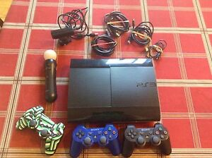 PS3 with controllers and 15 games