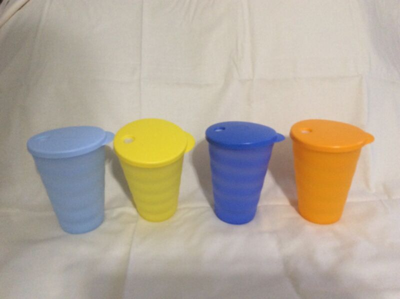 Brand new Tupperware Impressions 16 ounce Tumblers with seals. Set of four