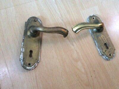 Pair old heavy brass lever door handles.