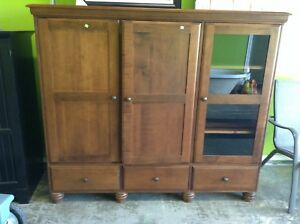 Gently Used T v Armoire at the HFH ReStore