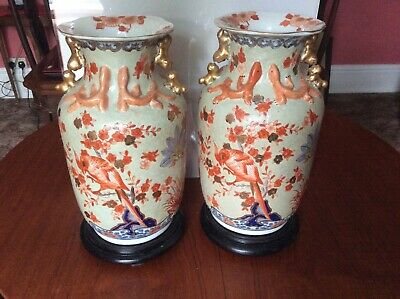 MATCHING PAIR OF LARGE CHINESE VASES ON HARDWOOD STANDS IN EXOTIC DESIGN