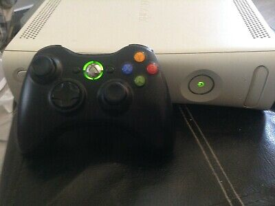 XBOX 360 WITH CONTOLLER, CABLES AND SEVEN GAMES