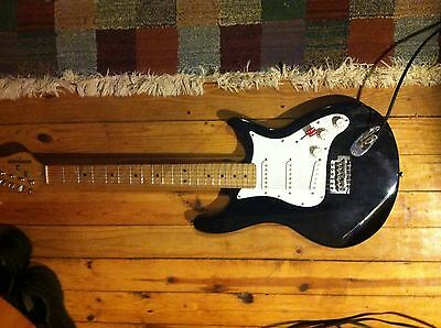 black/white Behringer electric guitar