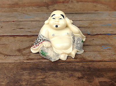 Smiling Resin Buddha with Erotic Scene Underneath