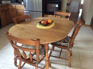 Roxton maple with 5 side chairs and one captain chair.