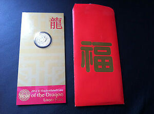 2012 $1 LUNAR SERIES YEAR OF THE DRAGON COIN ON CARD