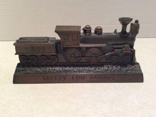 Vintage metal train coin bank, Railroadmen