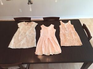 Gently used girls designer dresses, coat, shorts and tops.