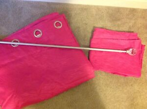 Hot pink blackout panel curtains and pretty curtain rod.