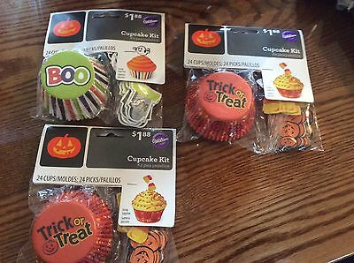 Wilton Halloween cupcake wrappers + decorative picks! ()