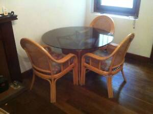 Vintage Rattan dining table and 4 chair set - good condition