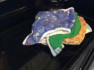Approx 7 diaper covers of varying sizes