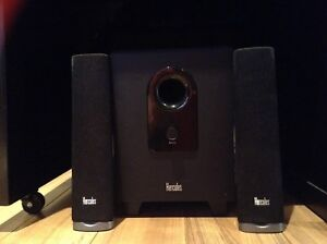 Three Hercules speakers