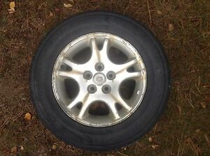 Set of 4 winter tires with original Dodge al. rims 215 65 R16