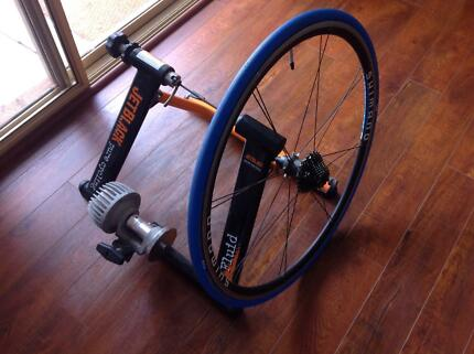 Jetblack Cycling Fluid Bike Trainer with Roller Compound Wheel Safety Bay Rockingham Area Preview